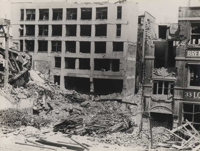 Alfred Place: east side, looking north-east - bomb damage after partial clearance, 14 July 1941. (Courtesy of Camden Local Studies and Archive Centre.)